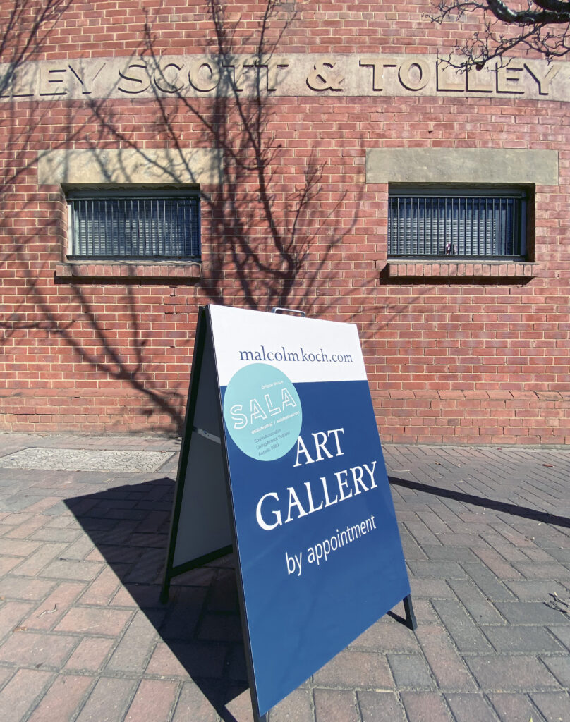 Sandwich board out the front of Malcolm Koch's art gallery