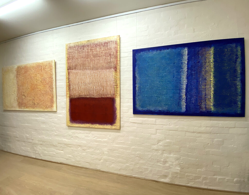 Paintings on display in Malcolm Koch's art gallery.